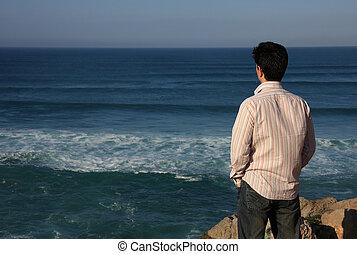 Contemplation - Young man enjoying a beautiful seascape