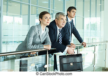 Contemplation - Three business people in office looking at...