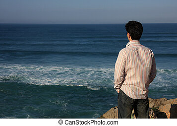 Contemplation - Young man enjoying a beautiful seascape