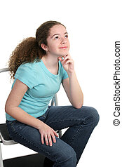 Contemplative Teen - A pretty teen girl sitting on a stool...