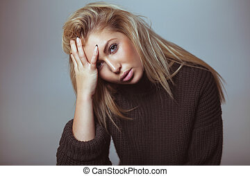 Contemplative woman in sweater