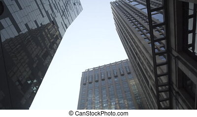 Contemporary architecture office building cityscape. Low angle of modern skyline office glass building. Skycrapers of modern city. Modern urban concept.