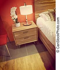 Contemporary bedroom in warm orange tones