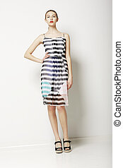Contemporary Clothes Collection. Woman in Spring Light Dress with Grey Streaks. Fashion