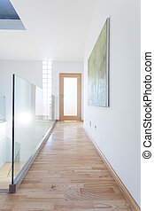 Contemporary corridor with glass banister - Interior of a...