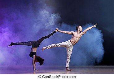 Sensual couple performing an artistical and emotional contemporary dance.