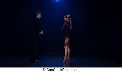 Contemporary dancing pair of professional elegant dancers in...