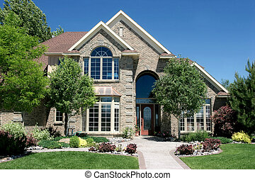 contemporary housing - a modern, newly built, american home...