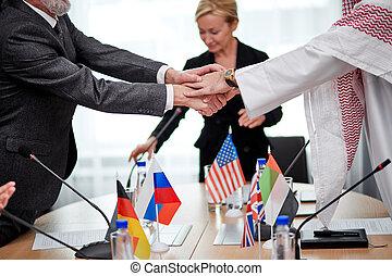 contemporary intercultural delegates shaking hands