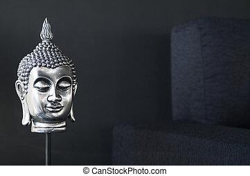 contemporary interior design detail with buddha image and sofa