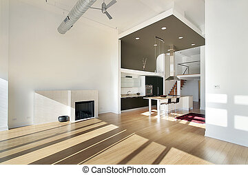 Contemporary kitchen in condominium with view from family...