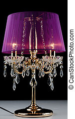 Contemporary glass table lamp isolated over black background