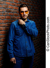 contemporary man - Jeans style. Portrait of a handsome young...