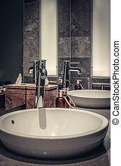 Contemporary mixer tap in the bathroom
