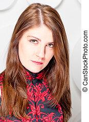 contemptuous look beautiful brunette in studio