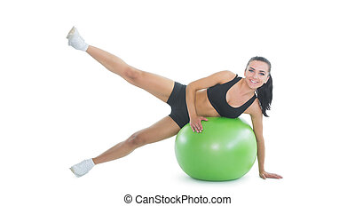 Content active woman doing an exercise on a green fitness ball
