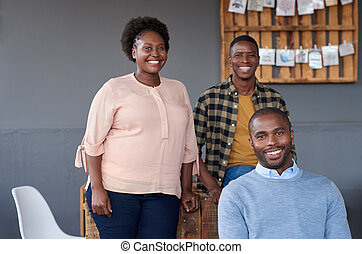 Content African businesspeople working together in a modern office