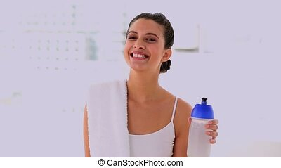 Content beautiful woman drinking water