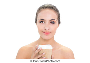Content brunette woman holding a cup of coffee