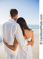 Content couple looking at the ocean