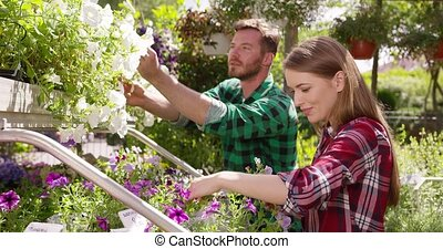 Content couple planting flowers together
