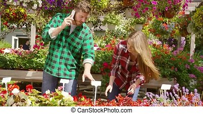 Content couple working in floral garden