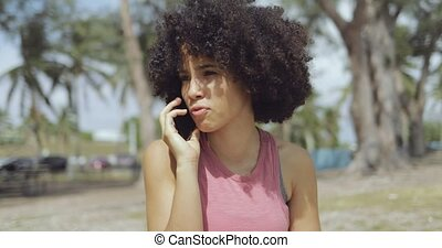 Content ethnic woman speaking on phone