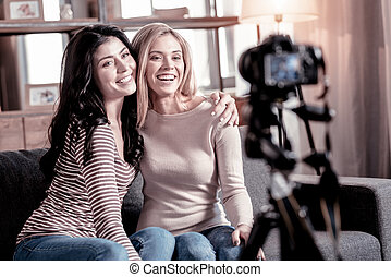 Content female vloggers recording a video