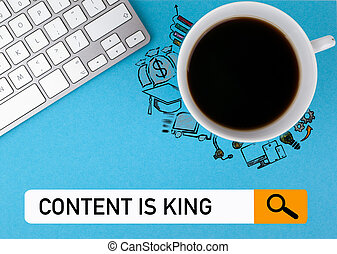 content is king concept. On a blue background coffee mug and computer keyboard