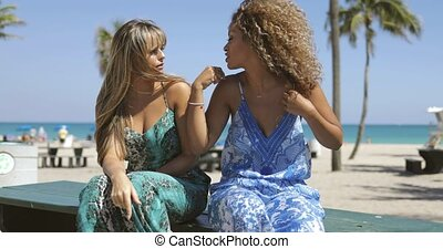 Content laughing women on tropical coast - Charming...
