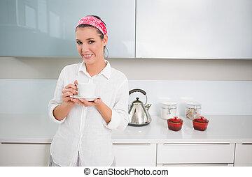 Content pretty woman holding tea