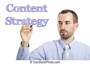 Content Strategy - Young businessman writing blue text on transparent surface