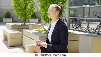 Content student with smartphone - Young girl wearing formal...