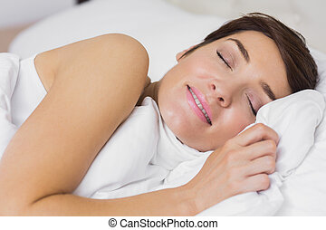 Content woman asleep