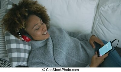Content woman enjoying music