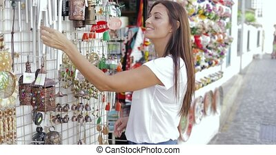 Content woman exploring street shop - Side view of young...
