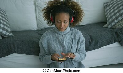 Content woman listening to music at home