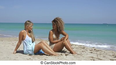 Content women enjoying tropical beach - Beautiful happy...
