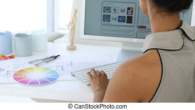 Content young businesswoman working at her desk