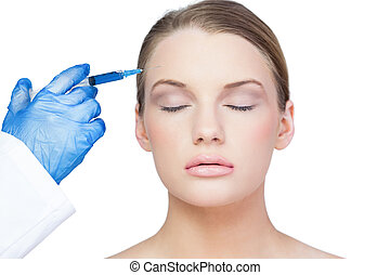 Content young model having botox injection