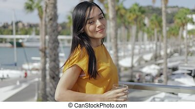 Content young woman enjoying views of resort - Side view of ...