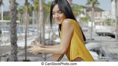 Content young woman enjoying views of resort - Side view of...
