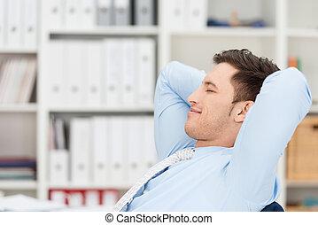 Contented businessman taking a break