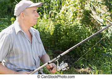 Contented senior fisherman