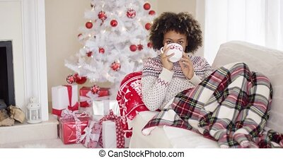 Contented woman in sweater laying on couch - Contented woman...