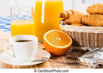 continental breakfast: coffee, orange, croissant and juice