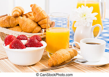 continental breakfast: coffee, strawberry and cream,...