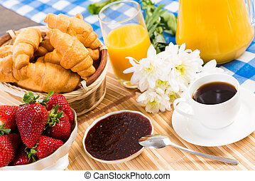continental breakfast: coffee, strawberry, croissant and...