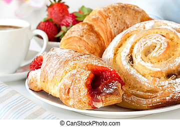 Continental breakfast with assortment of pastries, coffees and fresh strawberries.