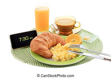 Continental hotel breakfast with scrambled eggs, croissant, coffe, orange juice and alarm clock showing early morning